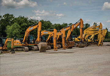 Construction equipment for sale, including backhoes, skid steers, excavators, compaction, pavers, and more.